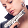 Beautiful girl in black leather jacket and beretta gun in her hands - Foto de Stock  