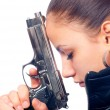 Portrait of beautiful girl in black leather jacket holding beretta gun — Stock Photo