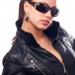 Beautiful girl in black leather jacket and black sunglasses — Stock Photo