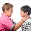 Two angry teenage boys holding each other necks during the fight — Stock Photo