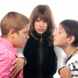 Teenage girl trying to separate two angry teenage boys — Stock Photo