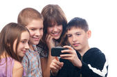Teenage boy showing digital content on his mobile phone to his friends — Stock Photo