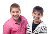 Two handsome teenage boys smiling isolated on white background — Stock Photo