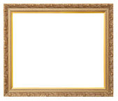 Beautiful vintage golden frame for paintings decorated with carvings — Stock Photo
