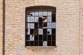 Old building with cracked windows — Stock Photo