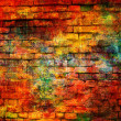 Stock Photo: Art grunge brick wall background in red, yellow and orange colors