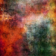 Colorful grunge texture in red, orange, green and yellow tones — Stock Photo