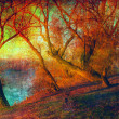 Art grunge landscape showing trees beside the river on sunny autumn day — Stock Photo