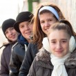 Teenage friends enjoying each others company on cold winter day — Stock Photo #8910692
