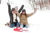 Two beautiful teenage girls having fun in the thick snow — Stock Photo