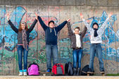 Happy teenage boys and girls having fun in urban environment — Stock Photo