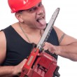 Crazy or mad lumberjack licks the blade of dirty electric saw — Stock Photo #9002498
