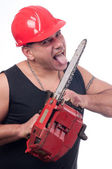 Crazy or mad lumberjack licks the blade of dirty electric saw — Stock Photo