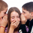 Two teenage boys telling jokes to teenage girl — Stock Photo #9045573