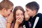Two teenage boys telling jokes to teenage girl — Stock Photo