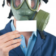 Professional with gas mask and helmet holding business card with place for — Stock Photo #9097855