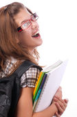 Pretty teenage girl posing with school bag on her shoulder and notebooks in her hands — Foto de Stock