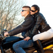 Young happy couple ready to go on a ride with motorcycle on beautiful autumn day — Foto de Stock
