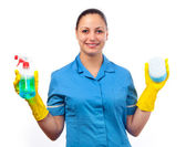 Smiling cleaning lady holding bottle of detergent in one hand and sponge in the other isolated on white — Stock Photo