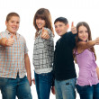 Group of happy teenage friends holding thumbs up — Stock Photo #9456853