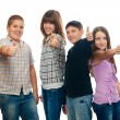 Group of happy teenage friends holding thumbs up — Stock Photo