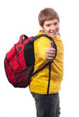 Handsome chubby teenage boy with school bag on his back showing thumbs up isolated on white — Stock Photo