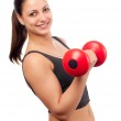 Young smiling attractive woman exercising with red dumbbell isolated on white — Stock Photo #9616639