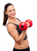 Young smiling attractive woman exercising with red dumbbell isolated on white — Stock Photo