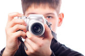 Teenage boy taking pictures with point and shoot camera — Stock Photo