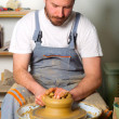 Craftsman making vase from fresh wet clay on pottery wheel. — Stock Photo