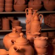 Beautiful ceramic bowls, teapots and bottles in pottery shop — Stock Photo #9720845