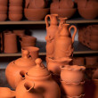 Beautiful ceramic bowls, teapots and bottles in pottery shop - Stock Photo
