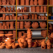 Beautiful ceramic bowls, teapots and bottles in pottery shop — Stock Photo #9720989