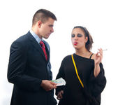 Young businessman giving money to the girl of questionable moral — Stock Photo