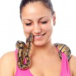 Cute smiling teenage girl playing with small pet python isolated on white — Stock Photo #9887435