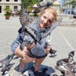 Happy woman with pigeons in Havana — Stock Photo