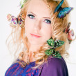 Beautiful woman with butterflies in hair — Stockfoto