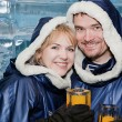 Happy couple having a drink in ice-bar — Stock Photo