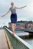 Woman on a bridge — Stock Photo