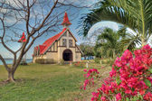 Red roofed church in Mauritius — Stok fotoğraf