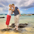 Happy couple on the beach — Stock Photo
