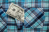 Crumpled five dollars in poket shirt — Stock Photo