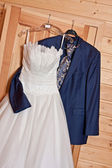 Wedding dress and suit — Stock Photo