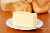 Pound of butter with bread — Stock Photo