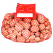 Mixed nuts in a mesh bag — Stock Photo