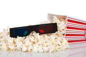 Black 3D glasess with spilled popcorn — Stock Photo