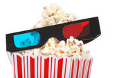 Closeup 3D glasses with popcorn — Stock Photo