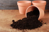 Garden Clay pot with spilled dirt — Stock Photo