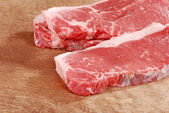 Strip loin steak on wood — Stock Photo