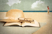 Vintage beach with book and hat — Stock Photo